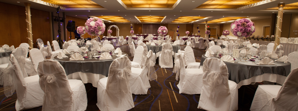Banquet setup with grey tablecloths and floral centrepieces