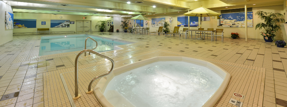 Bubbling hot tub and sparkling pool inside Edmonton hotel