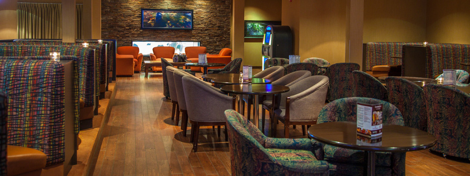 Casual lounge with plush seating, wall decor and jukebox