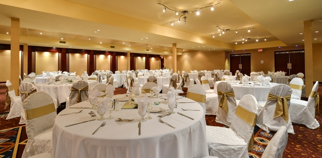 Edmonton ballroom with intimate lighting and round tables