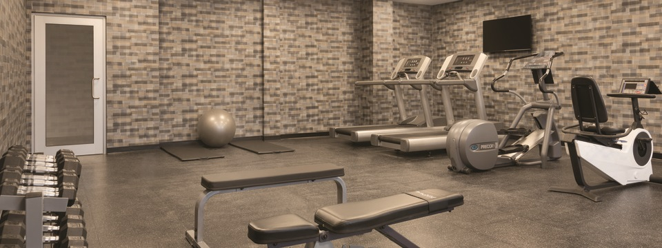 Fitness center with treadmills, free weights and more
