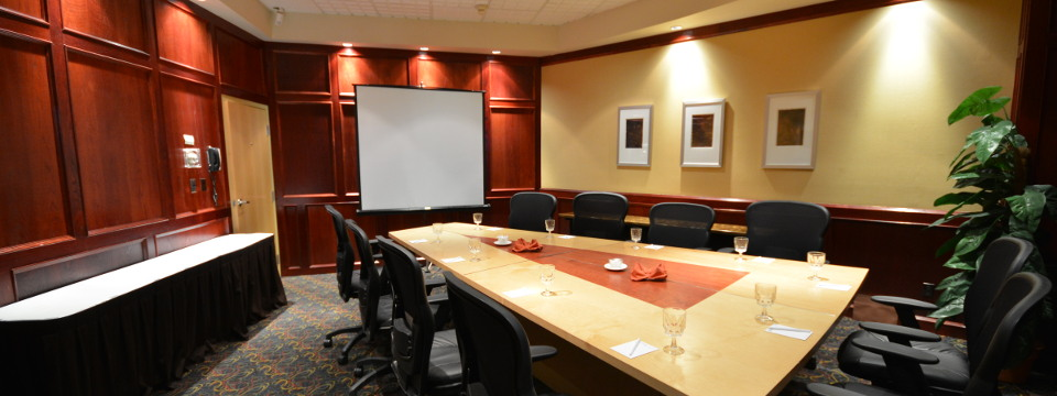 Wedge-shaped conference table in boardroom