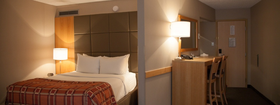 Red Deer hotel suite with a two-seat work desk