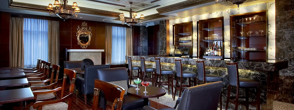 Hotel's Regal Lounge with bar seating and tables