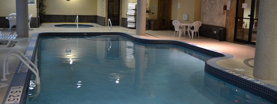 Hotel's indoor pool with seating area and towels