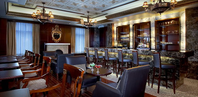 Hotel's Regal Lounge with tables and bar seating