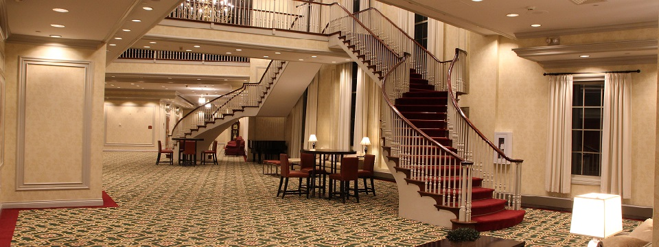 Foyer outside ballroom with elegant staircase