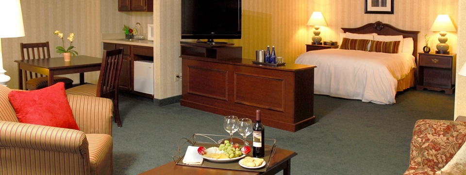 Hotel suite with Sleep Number® bed and kitchenette