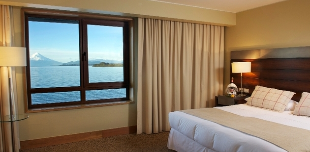 Hotel room with window overlooking lake