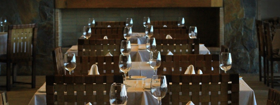 Dining tables set with wine glasses