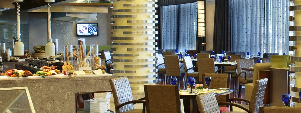 Tianjin hotel's restaurant with a buffet and cool color scheme