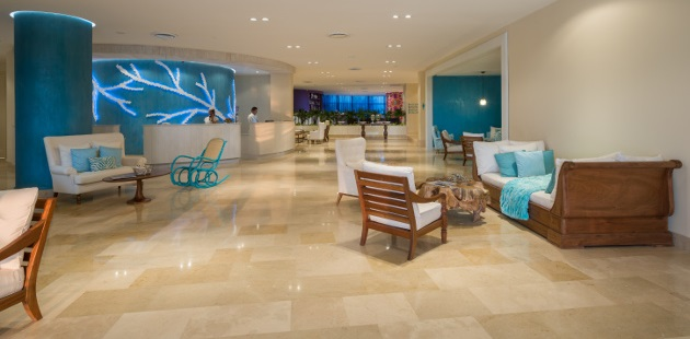 White seating with blue accents in vibrant hotel lobby