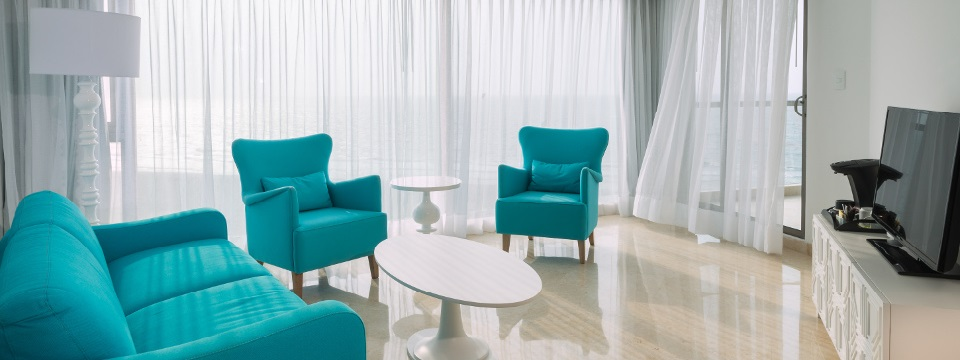 Vibrant blue seating in Master Suite seating area