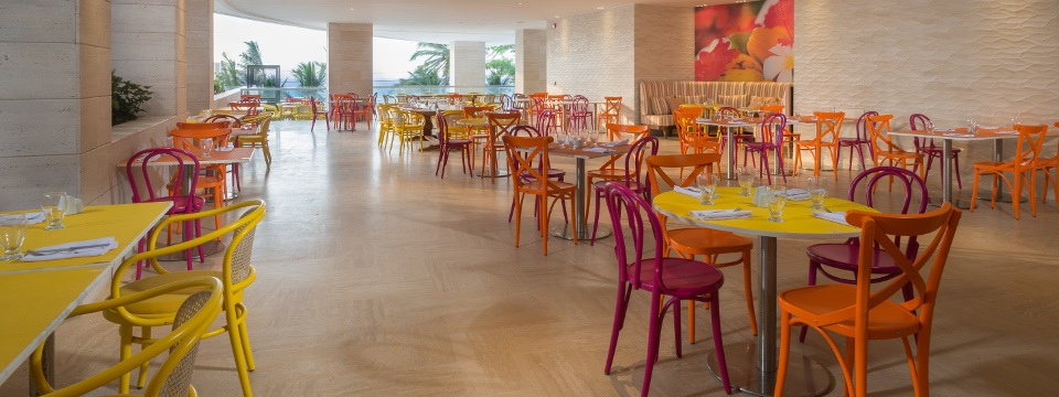 Open-air restaurant seating with warm colors