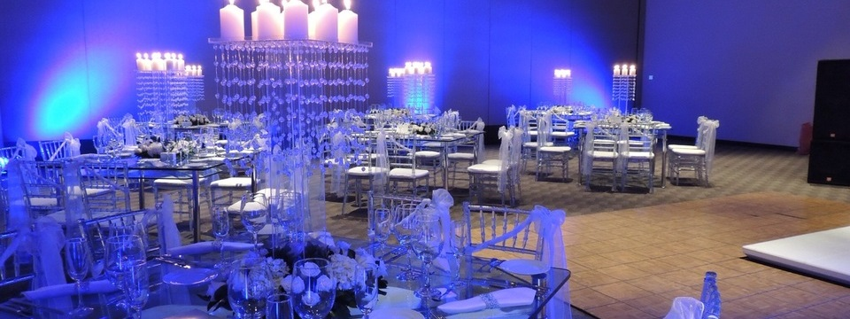 Wedding venue with ample seating, a dance floor and mood lighting