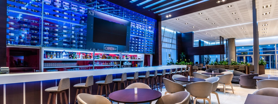 On-site bar with tables, chairs and soft blue lighting