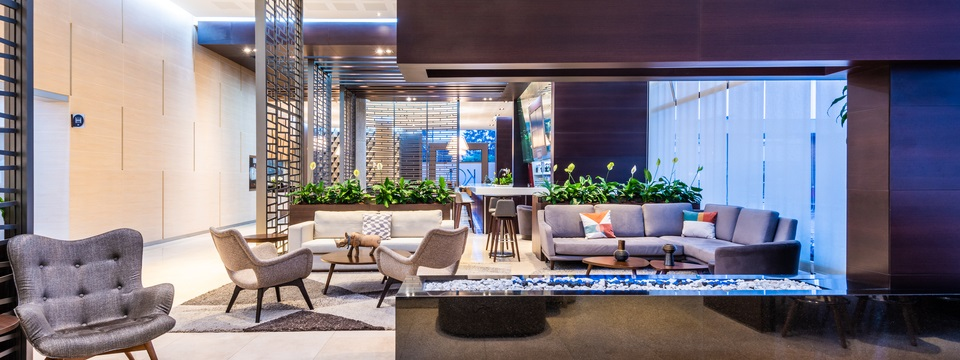 Comfortable, modern lobby with chairs, a sofa, a sectional and a fireplace