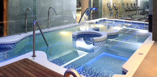 Sparkling indoor pool and fitness center