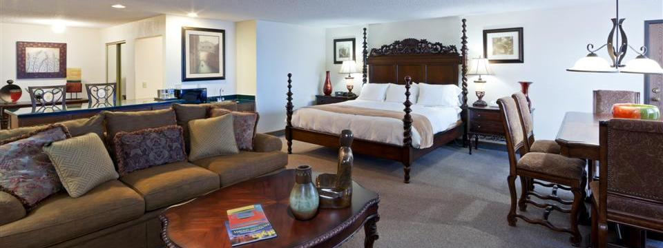 Spacious suite with king bed, sleeper sofa and dining table