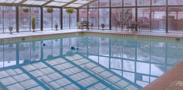 Sparkling heated indoor pool with natural light
