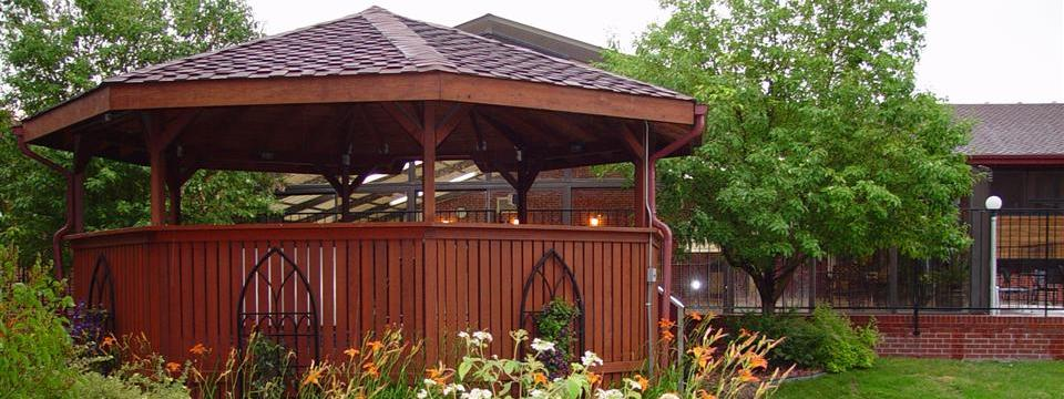 Outdoor hot tub beneath gazebo