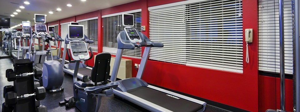 Fitness center with free weights, stationary bike and treadmill