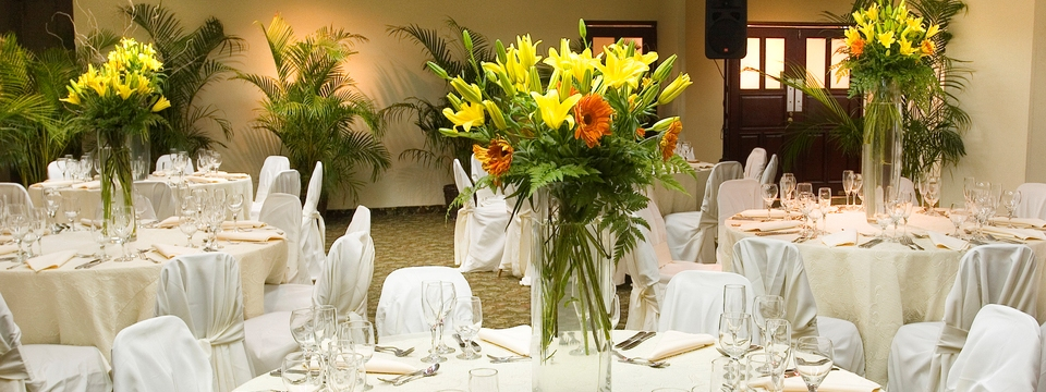 Banquet tables with white linens and floral centerpieces