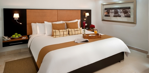 Room with king bed, bedside tables and room service