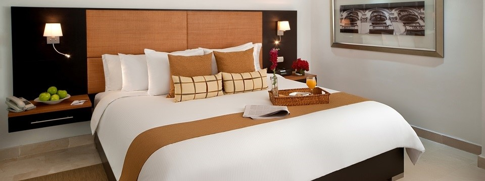 Hotel room with king bed, bedside tables and room service