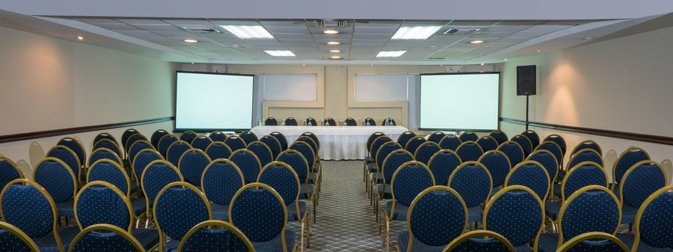 Conference-style setup and projection screen