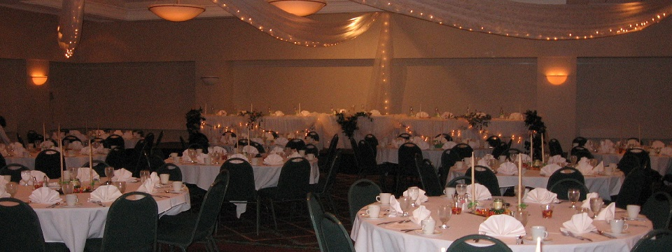 Ballroom setup with round tables for dinner reception