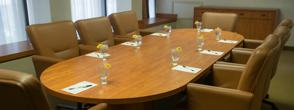 Hotel's boardroom with table and eight leather chairs