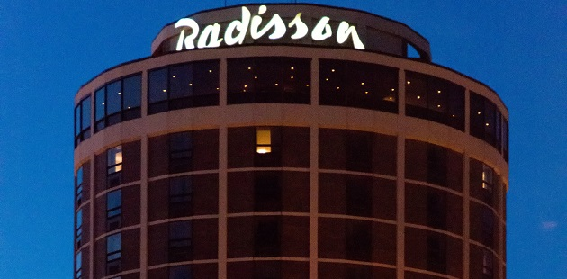 The Radisson hotel exterior at night