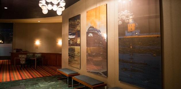 Hotel lobby with large paintings and bench seating