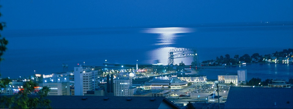City view of Duluth harbor lit up at night
