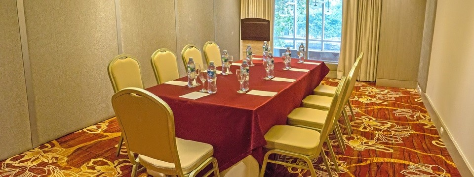 Meeting room with rectangular table and lectern