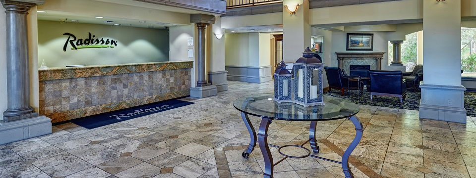 Welcoming lobby with reception desk and seating area