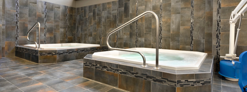 Two hot tubs with tile detailing at Fargo hotel
