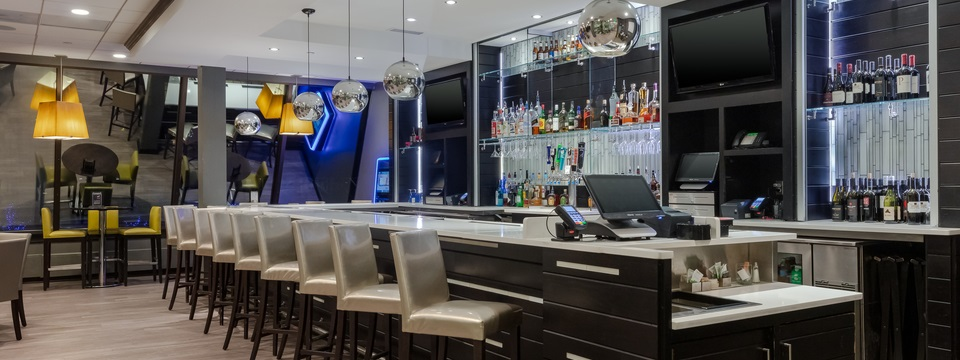 On-site restaurant featuring a full bar with silver chairs