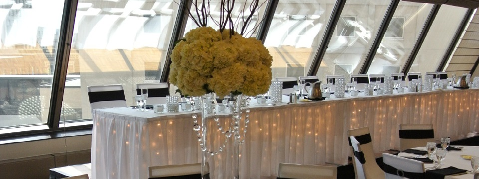 Head table and floral arrangement in Fargo ballroom