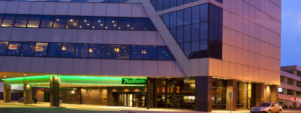 Green lighting at front entrance of Radisson Hotel Fargo