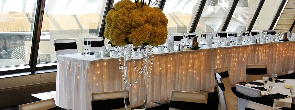 Elegant floral arrangement with head wedding table in background