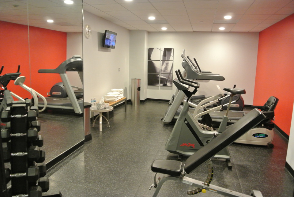 Exercise machines facing a flat-screen TV