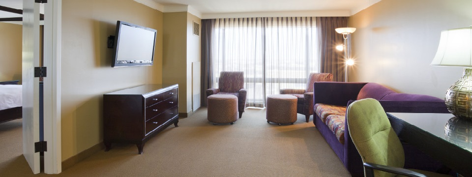 Presidential Suite living area with sleeper sofa and TV