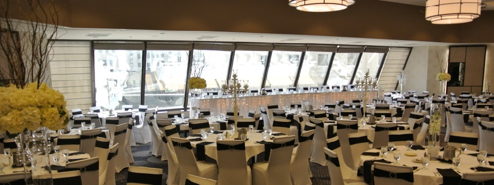 Round tables with black-and-white decor in Cityscape Ballroom