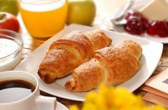 Croissants with coffee and orange juice