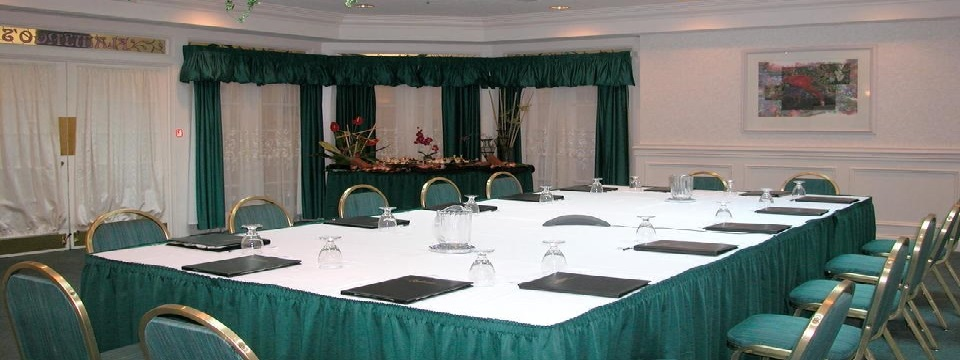 Meeting room set up boardroom style with a buffet