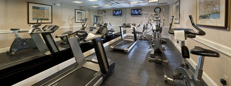 Modern exercise equipment in hotel fitness center
