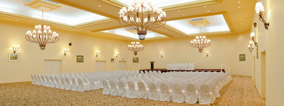 Elegant ballroom featuring coffer ceilings and ornate chandeliers