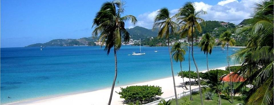 View of Grand Anse Beach with sail boats in the water